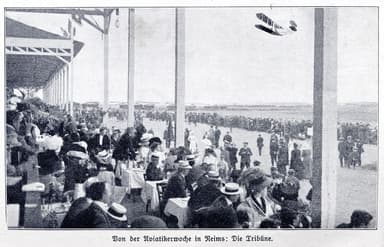 A French-Built Wright Biplane Flies in Front of the Packed Grandstand