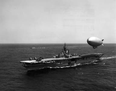 A U.S. Navy airship hovers over the carrier Leyte refueling (May 5, 1955)