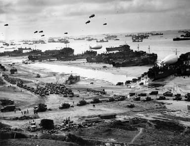 Barrage Balloons Protecting Cargo Vessels During Battle of Normandy
