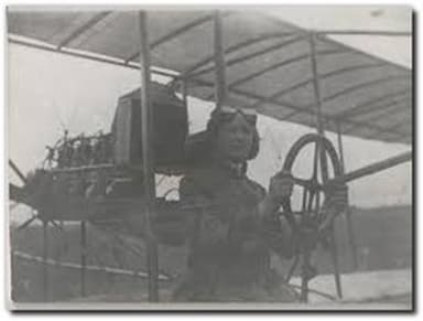 Bessie at the Controls of the Family Biplane