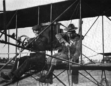Jacob Earl Fickel with Glenn H. Curtiss Shooting from an Airplane in 1910