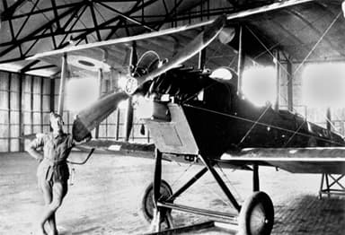 Mechanic with a De Havilland DH6 Two-Seater Biplane