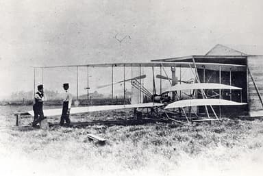 Orville and Wilbur Wright with Wright Flyer II at Huffman Prairie (May 1904)