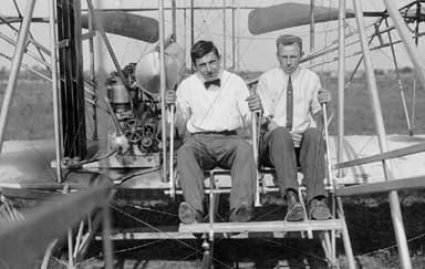 Pilot and Co Pilot at Controls of Model A Flyer