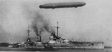 The German Battlecruiser SMS Seydlitz with a Zeppelin Overhead