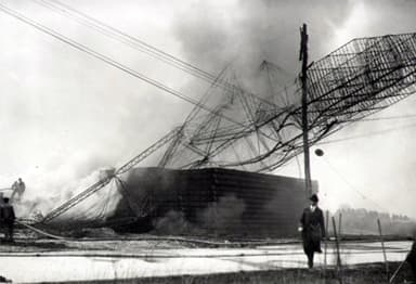 The wreckage of the Roma burns after it crashed into power lines