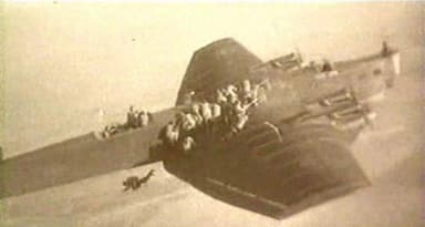 Paratroopers Jumping from a Tupolev TB-3