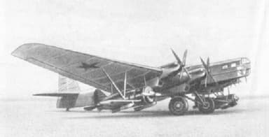Tupolev TB-3 with Polikarpov I-16 Fighters Armed with 250-Pound Bombs